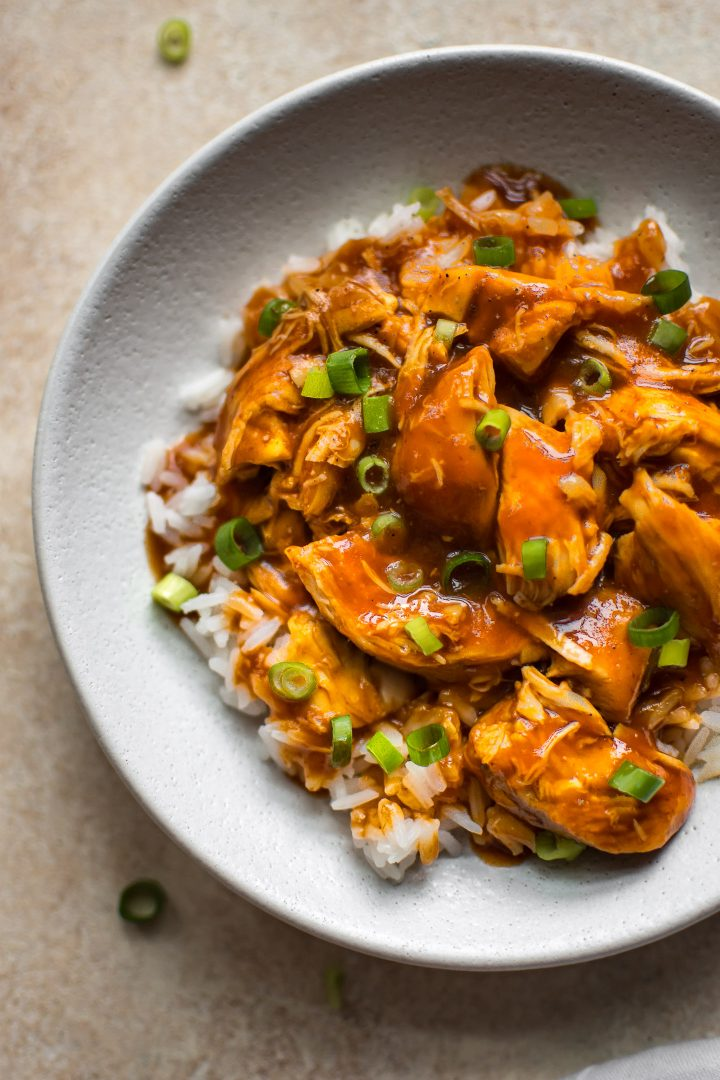 Instant Pot sriracha chicken - a sweet and spicy weeknight dinner that's delicious served with rice and scallions. One flavorful meal with a handful of simple ingredients.