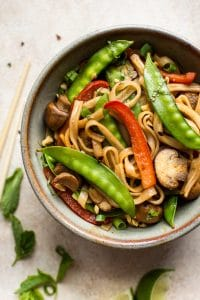 This vegan rice noodle stir fry is quick, easy, and loaded with veggies and bold flavors. The sauce is infused with ginger, garlic, soy sauce, hoisin sauce, and sriracha!