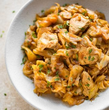 Sautéed cabbage and chicken is a healthy and delicious stir fry. Tender chicken breast, onions, and cabbage sautéed with garlic and paprika make a comforting family dinner! Delicious served with a dollop of sour cream!