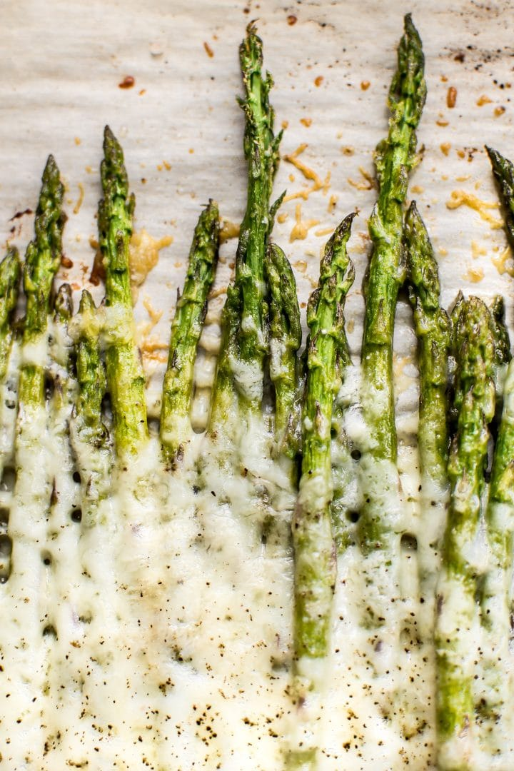 This low carb asparagus recipe is the best comfort food side dish! Loaded with parmesan cheese, mozzarella, and garlic, it's melty cheesy perfection.