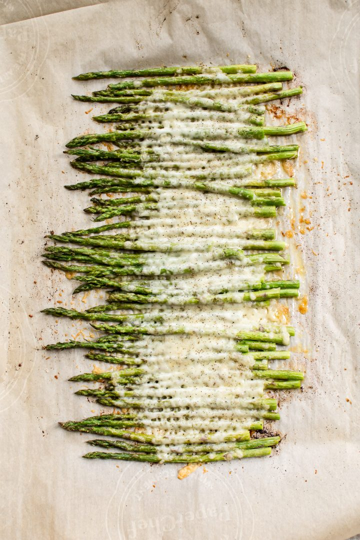 This easy cheesy garlic roasted asparagus comes together in less than 20 minutes. It's a low-carb side dish that the whole family will love!