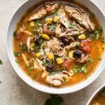 This easy Crockpot chipotle chicken soup is easy to make, spicy, and delicious! Corn, black beans, tender chicken, fire-roasted tomatoes, and chipotle chili peppers in adobo sauce make this one tasty soup.