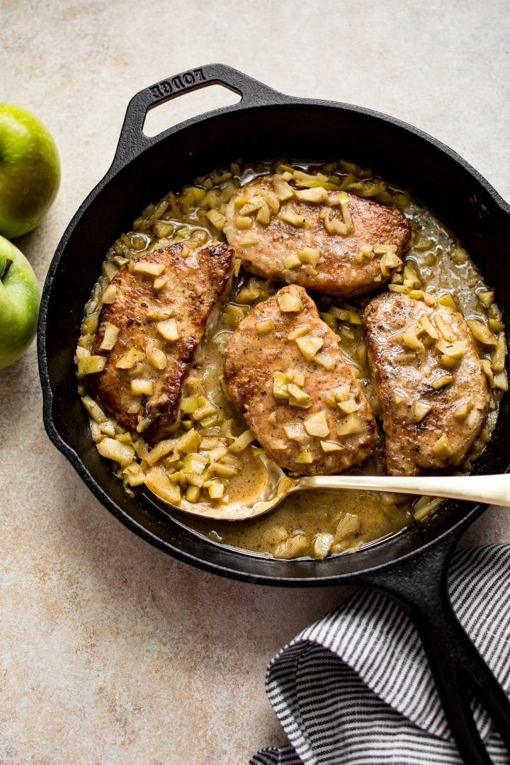 Delicious boneless pork chops with apples - a simple skillet recipe with Granny Smith apples, pork, and a delicious buttery sauce. So easy! The whole family will love it.