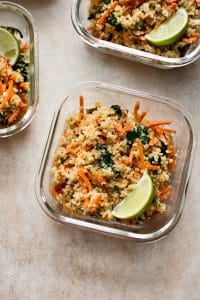 Want more plant based meals? These vegan meal prep bowls with spinach, carrots, quinoa, and a delicious light dressing are quick and easy. Great for meal prep beginners!