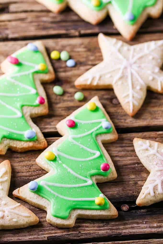 several sugar cookies with easy icing in star and tree shapes