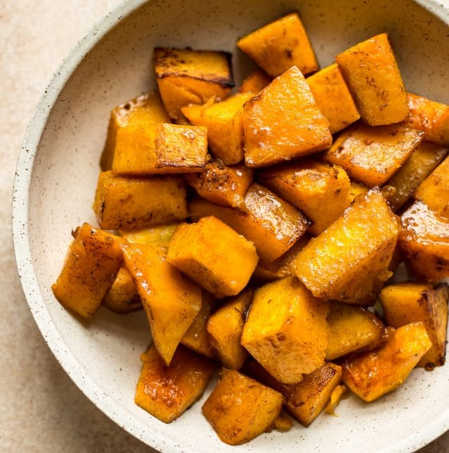 This easy honey roasted butternut squash recipe is a tasty vegetarian side dish that's perfect for your holiday menu. It's simple to make and sure to be a hit!