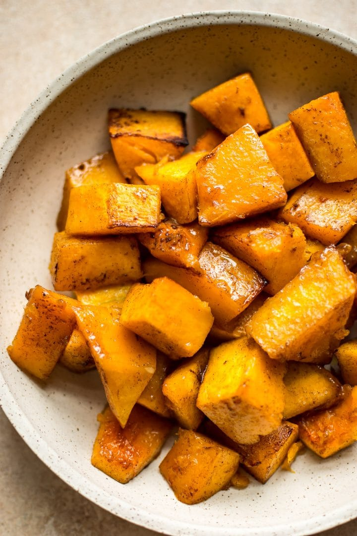 This honey cinnamon butternut squash recipe is perfect for fall, Thanksgiving, and/or Christmas! Tender sweet and savory roasted squash is perfectly caramelized to make the most delicious family friendly side dish.