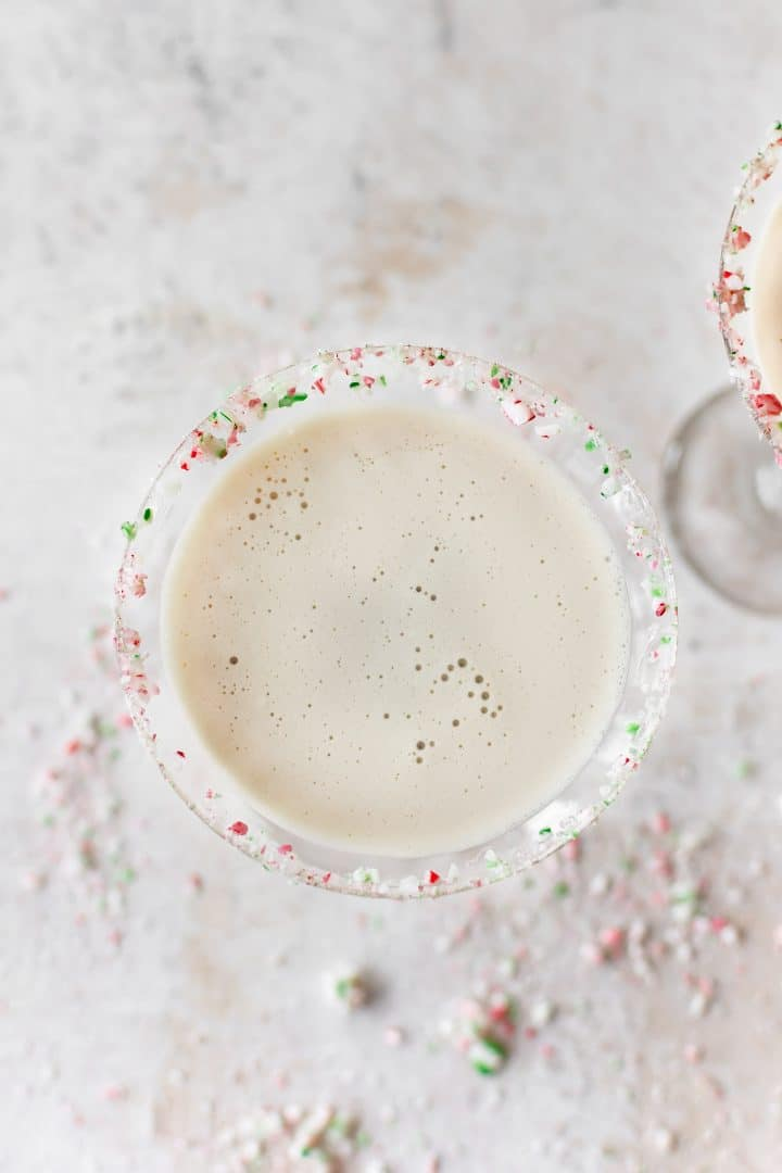 The yummiest creamy Christmas cocktail recipe has crushed candy canes, Creme de Cacao, Baileys, and Peppermint Schnapps. Easy and fast!