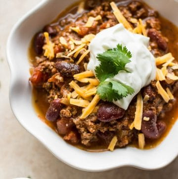 This quick and easy Instant Pot beef chili is made fast in your electric pressure cooker. The perfect family friendly game day recipe!