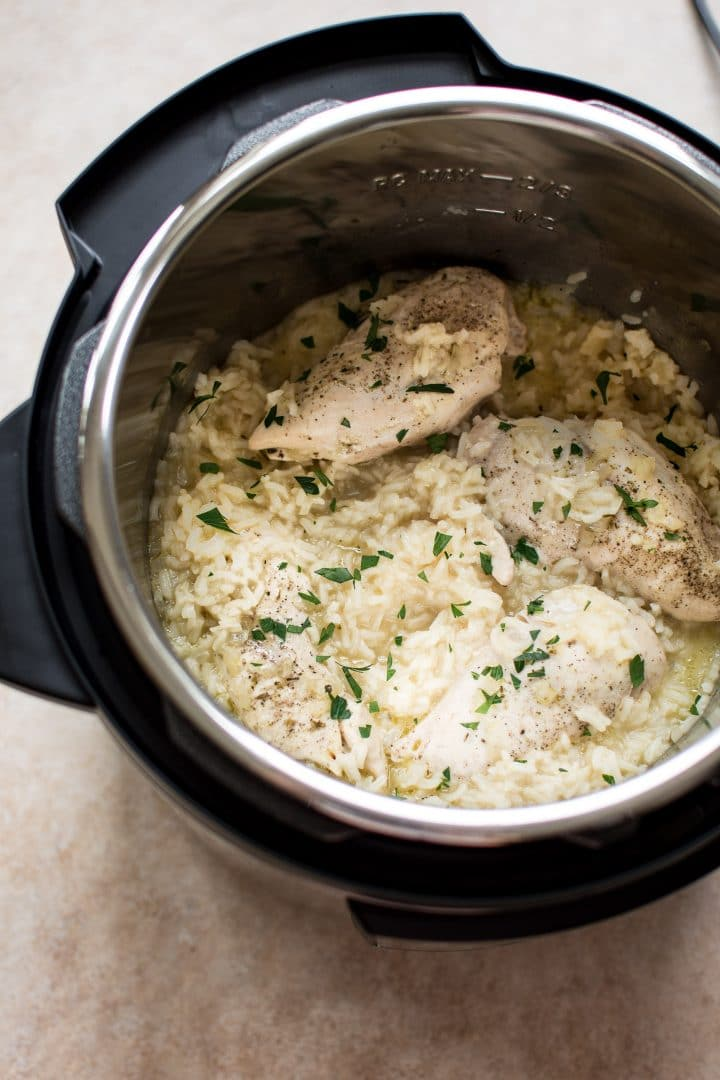 Chicken and rice all made in one pot in the electric pressure cooker. You'll love this family-friendly Instant Pot recipe!