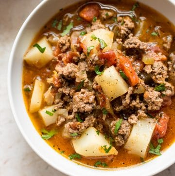 This easy hamburger soup recipe is comforting, healthy, and delicious. Lean ground beef, potatoes, and a tasty tomato broth make this a family favorite.