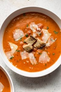 This easy tomato soup recipe is so much better than the canned variety! You can make this homemade tomato soup in about 30 minutes.