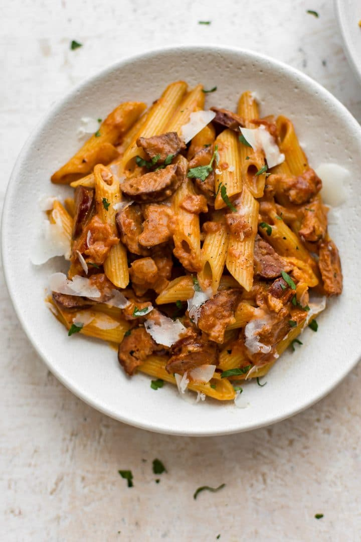 This spicy chorizo pasta is quick and simple! The tomato and cream sauce perfectly balances the sausage.