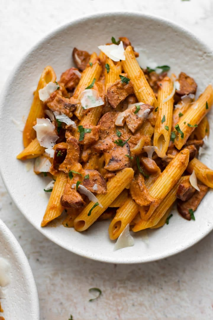 This easy chorizo pasta recipe is flavorful and fast! The sausage, tomato, and cream sauce is perfect served over penne.