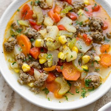 This easy sausage and vegetable soup is total comfort food! The whole family will love this delicious meal.