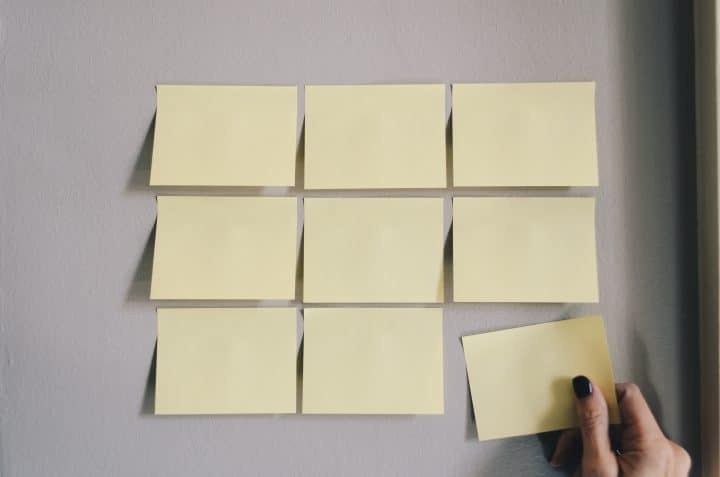nine yellow post-it notes on a wall