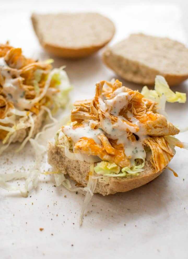 This Instant Pot buffalo chicken recipe is simple and crazy good. Your favorite hot wing flavor makes the best sandwiches. Perfect with ranch or blue cheese dressing!