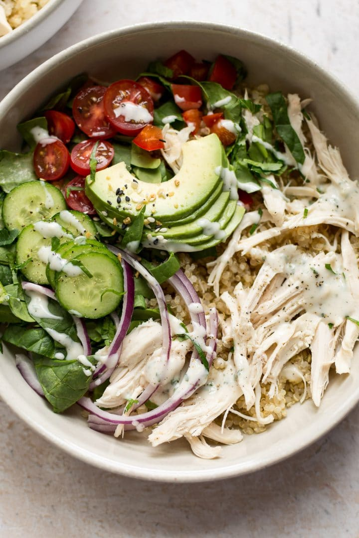 This ranch chicken quinoa salad is super simple and delicious. Avocado, red onion, tomatoes, cucumber, and a tasty homemade ranch dressing make this recipe a winner!