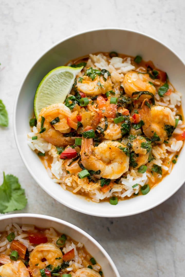 This Thai shrimp curry recipe has the most flavorful coconut broth that can be made spicy if you want. It's comforting, fresh, delicious, and easy to make.