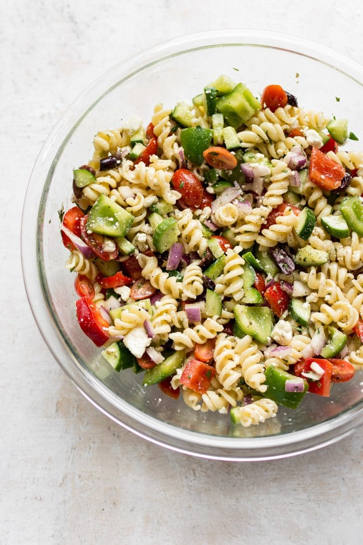 Glass prep bowl with cold Greek pasta salad