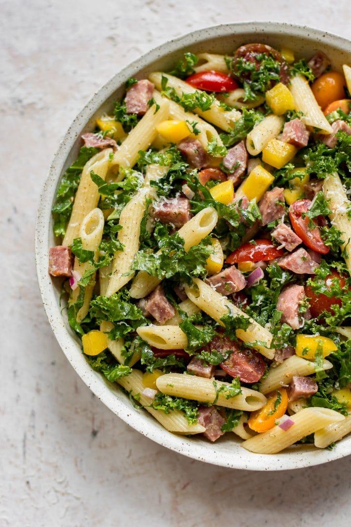 kale pasta salad in a serving bowl
