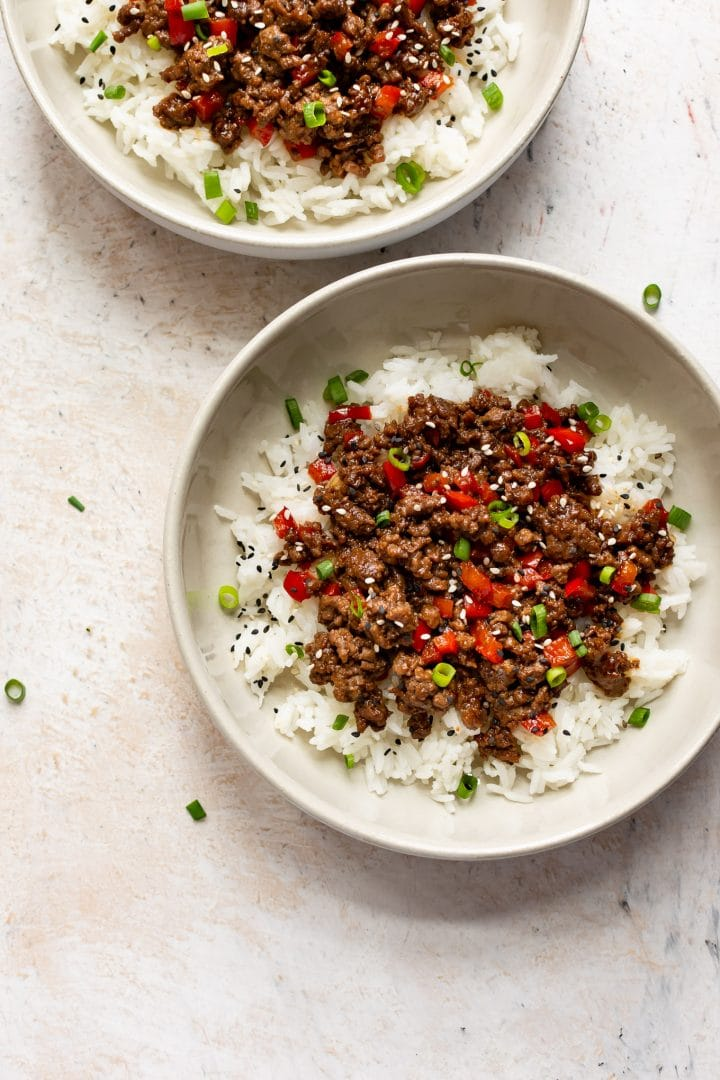 two ground beef bowls served with rice