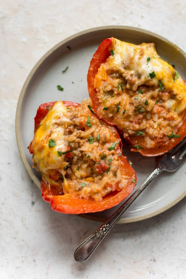 Italian sausage stuffed pepper cut in half on a plate