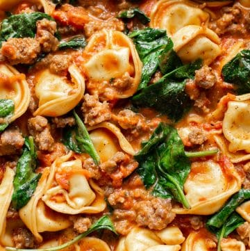 close-up of tortellini with spinach and sausage