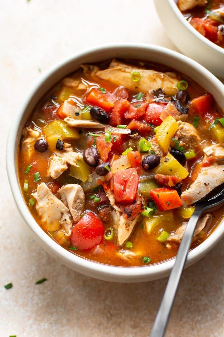 easy chicken fajita soup in two white bowls