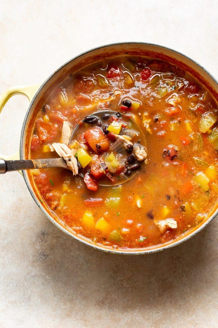 chicken fajita soup in a yellow pot