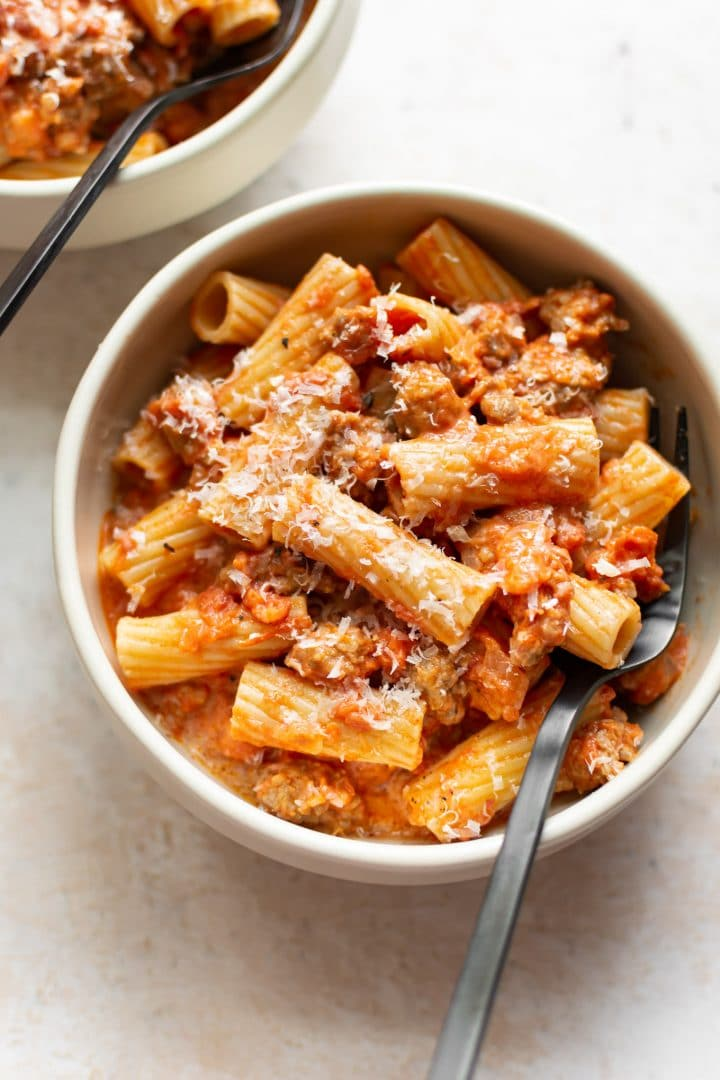 Italian sausage rigatoni in two bowls
