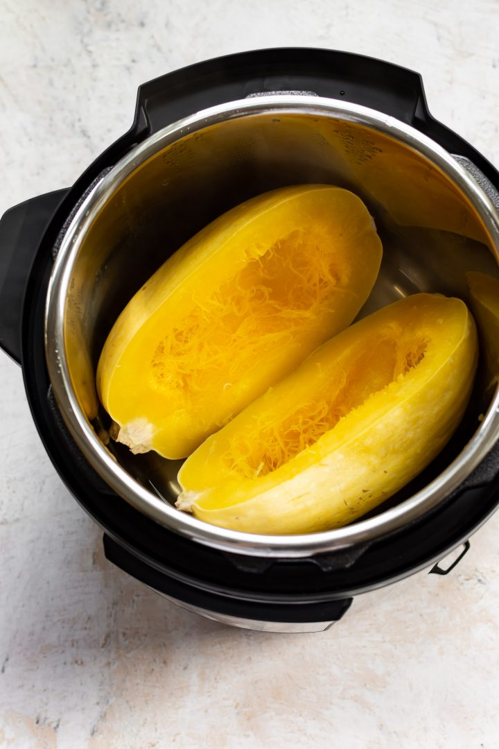 cooked spaghetti squash halves in an Instant Pot