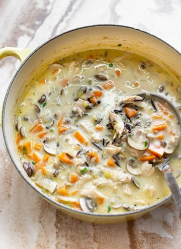 creamy turkey wild rice soup in a yellow soup pot