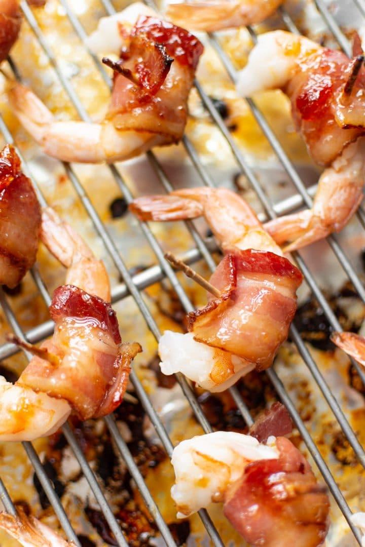 bacon-wrapped shrimp on baking sheet