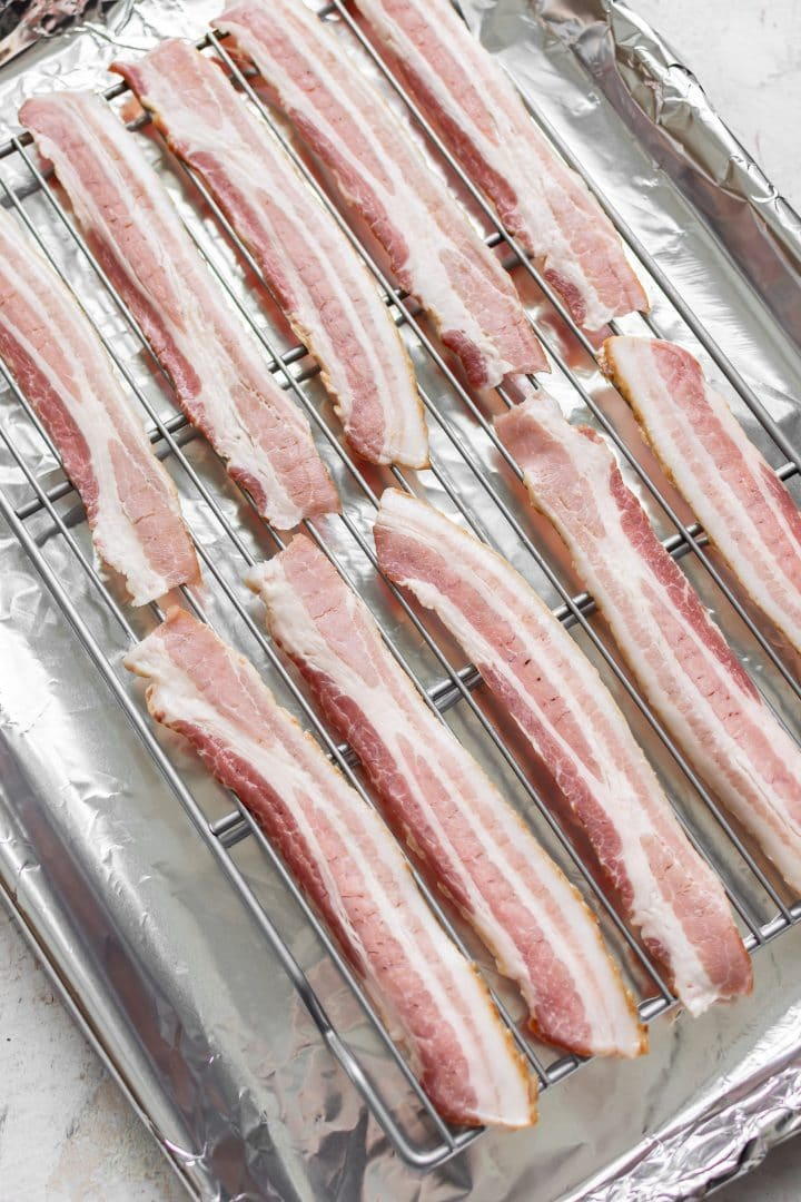 raw bacon on a wire rack (about to be cooked in the oven)