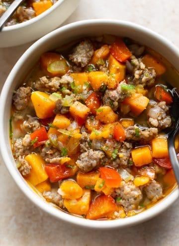 sausage sweet potato soup in two bowls
