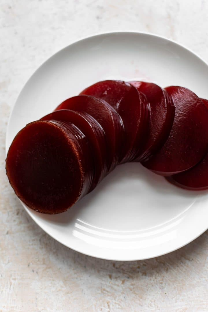 canned cranberry sauce sliced on a white plate