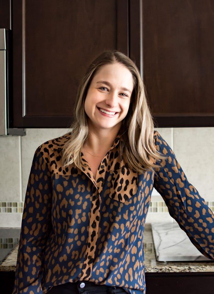 Natasha Bull of the food blog Salt & Lavender standing in her clean kitchen.