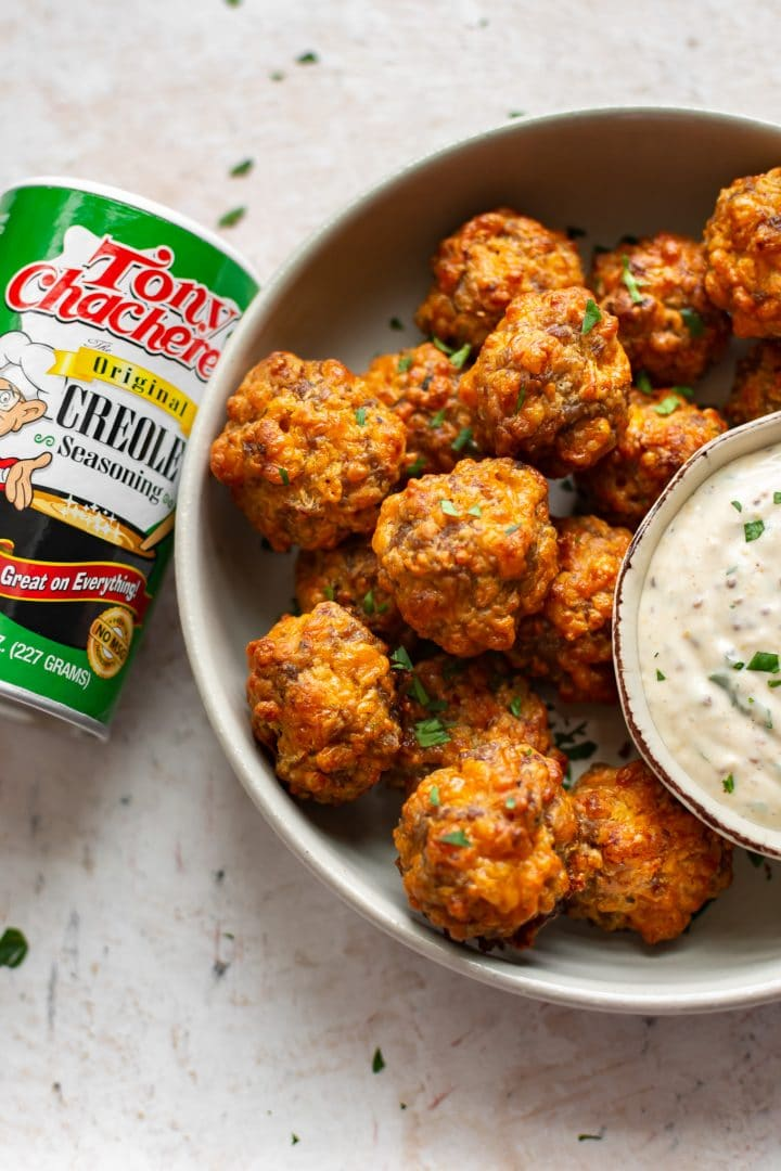 Creole sausage balls pictured with Tony Chachere's Original Creole Seasoning