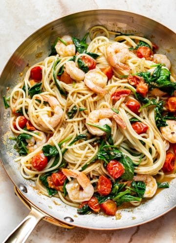 tomato spinach shrimp pasta in a skillet