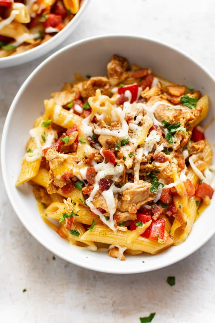 BBQ chicken pasta sauce over penne (in bowls)