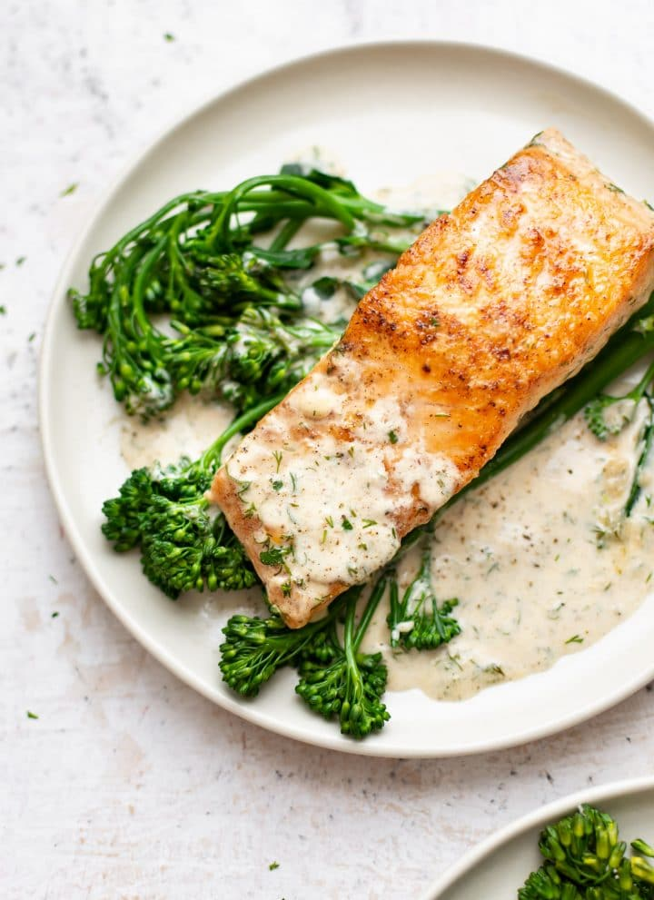 creamy dill salmon plated with broccolini and lots of sauce