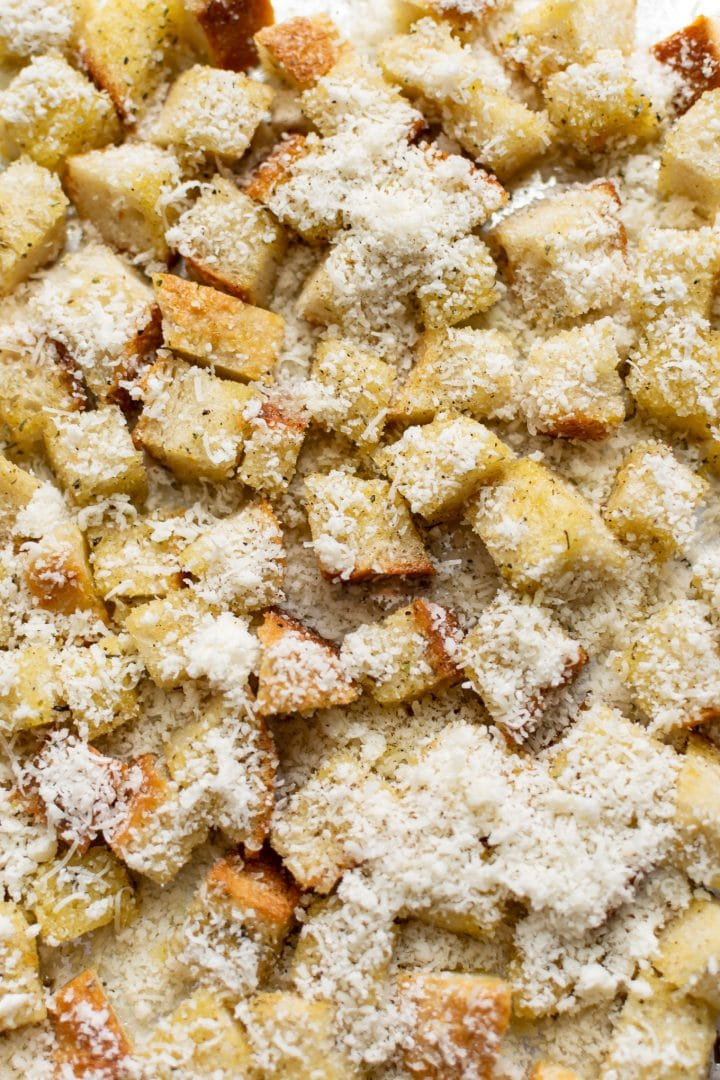 close-up of homemade croutons with freshly grated parmesan sprinkled over top... ready to go in the oven!