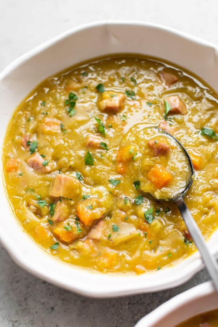The BEST Instant Pot split pea soup (close-up in a white bowl)