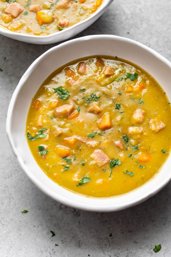 easy Instant Pot split pea soup with ham in two bowls