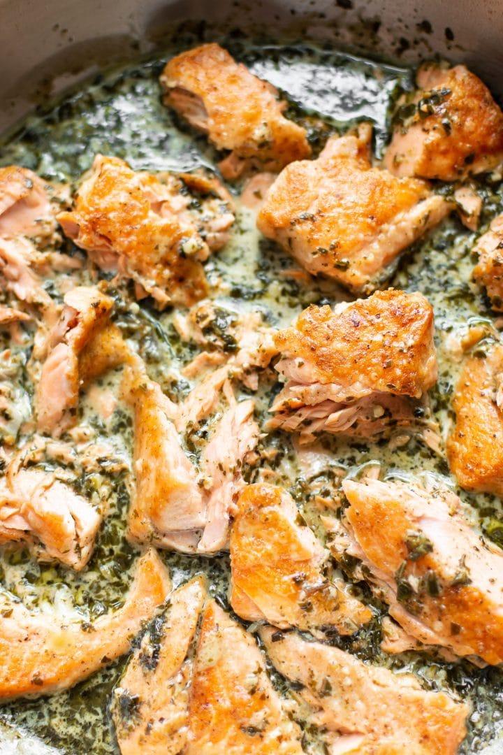 close-up of creamy salmon pesto pasta