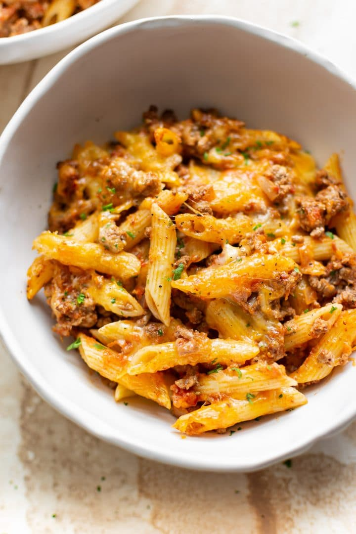 pasta bake with ground beef in a white bowl