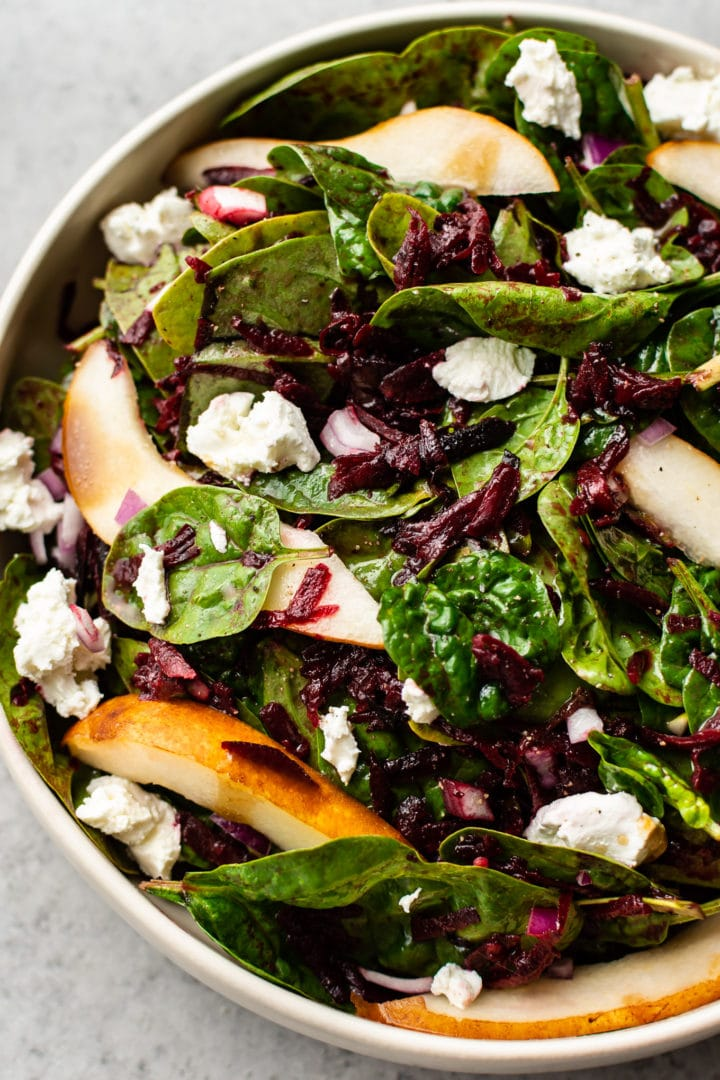close-up of beet spinach salad in a bowl