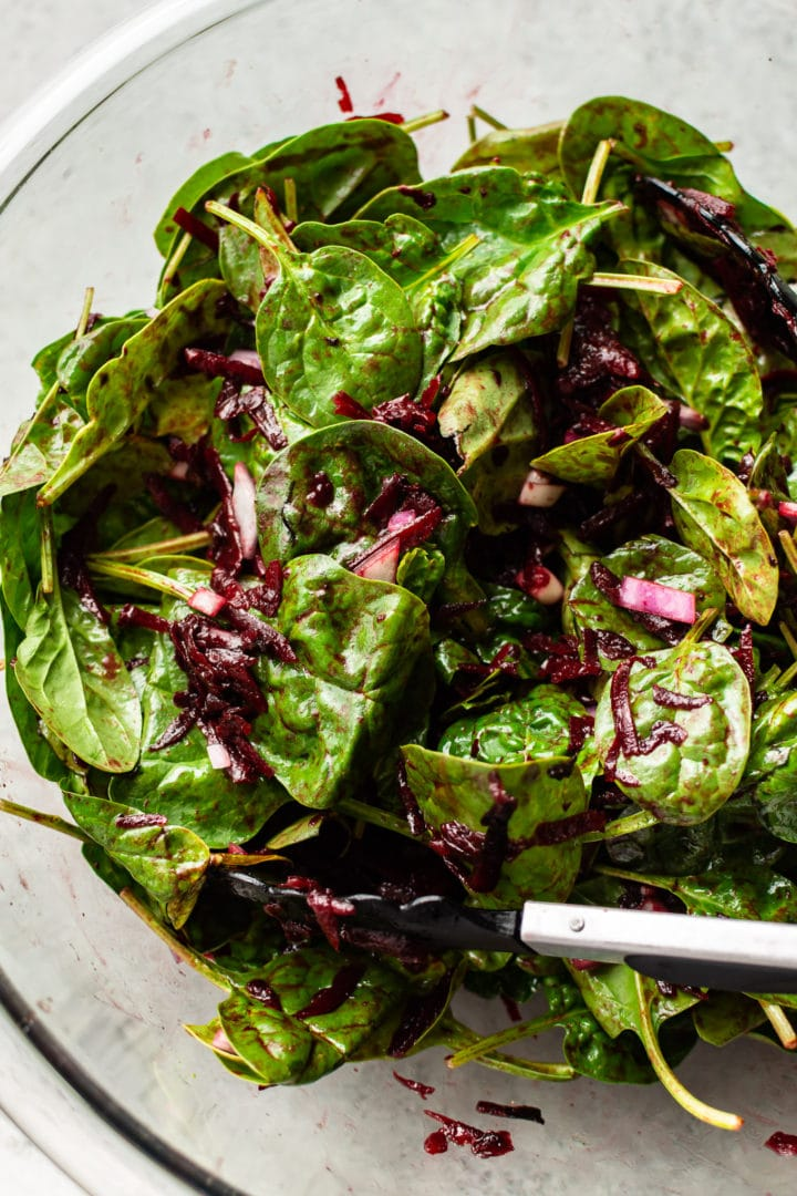spinach beet salad in a glass prep bowl