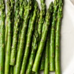 the best asparagus on a beige plate